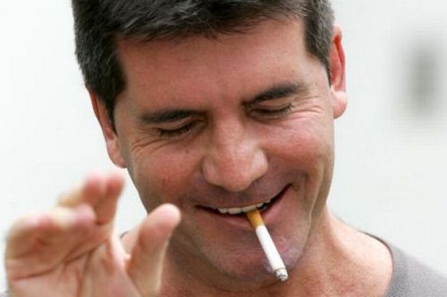 Simon Cowell Smokes