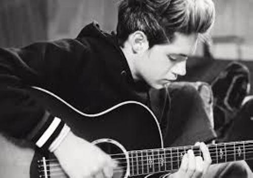 Niall Horan Playing Guitar